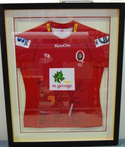 Signed football Jersey in deep rebate frame with double lifted mats under perspex