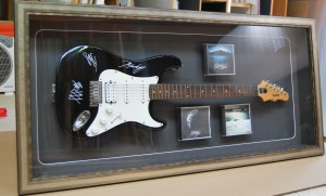 Signed Guitar and cd covers mounted in box and framed under perspex