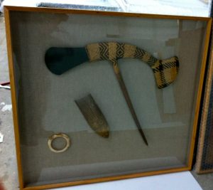 Indonesian Ax and artifacts mounted to raw linen and framed with deep blackwood exhibition frame