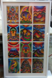 A Collage of Indonesian Pieces float mounted and frames under glass in a deep white shadow box frame